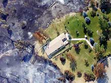 An aerial picture of a house saved on the Canyon Ferry Fire.