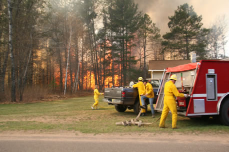 Volunteer fire department of Lac Court Oreilles Reservation preparing to fight a forest fire.